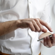 Image of a man using his phone representing the use of the My Health Guide app